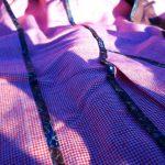 Détail des ganses de la veste en motif pied-de-poule de chez Hockerty